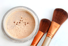 Close up of face powder and cosmetic brush. Close up of face powder and cosmetic brush Royalty Free Stock Images