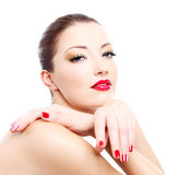 Close-up face of a sensuality  woman. With red bright manicure and lips Stock Image