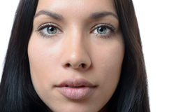 Close up of the face of a serious young woman Stock Photo