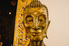 Close up face on starving Buddha head statue with lighting effect. Stock Image