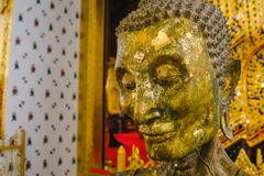 Close up face on starving Buddha head statue with lighting effect. Stock Images