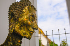 Close up face on starving Buddha head statue with lighting effect. Royalty Free Stock Image