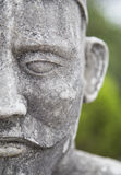 Close up of the face of stone statue Royalty Free Stock Image