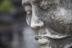 Close up of the face of stone statue Stock Photos