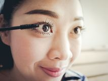 Close up face of woman putting make up. Royalty Free Stock Photo