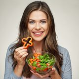 Close up face of woman with salad isolated portrait. Royalty Free Stock Photography