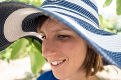 Close up of the face of a woman in a sunhat Royalty Free Stock Images