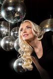Woman disco mirror ball. Close-up face of young blonde woman disco mirror ball in hands Royalty Free Stock Photography