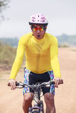 Close up face of young man riding mountain bike in dusty road us. E for bicycle sport out door and human activities leisure royalty free stock images