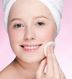 Close-up face of young woman applying sponge Stock Image