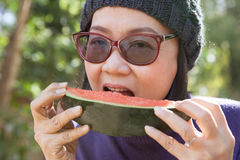 Close up face of young woman earting water melon Stock Photography