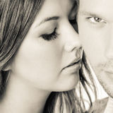 Close up faces. Of attractive couple, male's sharp gaze Stock Images