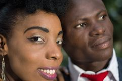 Close-up of faces of smiling young couple. Royalty Free Stock Photo