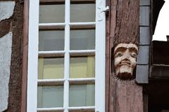 Close-up of faces wood carved in old houses in Rochefort-en-Terre, French Brittany stock photos