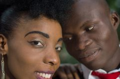 Close-up of faces of young couple in love. Royalty Free Stock Photo