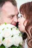 Close up faces of young couple with wedding flowers Royalty Free Stock Photo