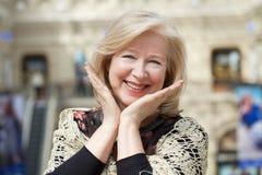 Close up facial portrait of a beautiful senior woman Stock Photos