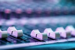 Close up of fader`s on sound mixing console. Details of sound engineer room. royalty free stock image
