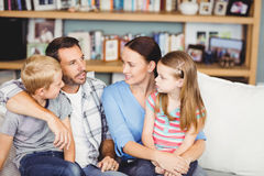 Close-up of family discussing on sofa Royalty Free Stock Photo