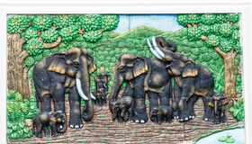 Close up family  elephants life stone mural in the park Stock Images