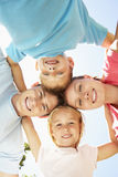 Close Up Of Family Group Looking Down Into Camera In Park Royalty Free Stock Image