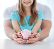 Close up of family hands with piggy bank Royalty Free Stock Image