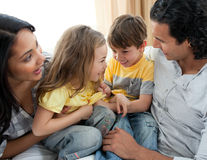 Close-up of family having fun on sofa stock images