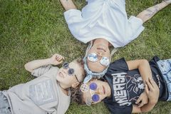 Close up of family lying on green grass. View from above. Happy family concept. royalty free stock photos