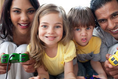 Close-up of family playing video game. In the living room Royalty Free Stock Image