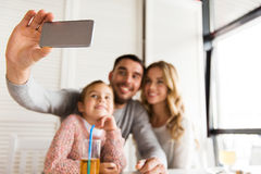 Close up of family taking selfie at restaurant Stock Image