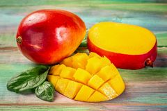Close-up Famous Alphonso mango slices over wood background, Flat top view, from above stock photo