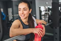Close up of fantastic and gorgeous brunette that is resting after hard working exercises. She is laning on the Royalty Free Stock Photo