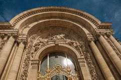 """Close-up of the far-fetched golden gate and arch in a sunny day at the Petit Palais in Paris. Known as the """"City of Light"""", is one of the most impressive Stock Photos"""