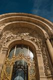 """Close-up of the far-fetched golden gate and arch in a sunny day at the Petit Palais in Paris. Known as the """"City of Light"""", is one of the most impressive Royalty Free Stock Photography"""