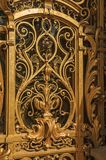 """Close-up of the far-fetched golden gate decoration at the Petit Palais entrance in Paris. Known as the """"City of Light"""", is one of the most impressive world Stock Image"""