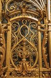 """Close-up of the far-fetched golden gate decoration at the Petit Palais entrance in Paris. Known as the """"City of Light"""", is one of the most impressive world Stock Images"""