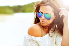Close up fashion beautiful woman portrait wearing sunglasses