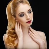 Close-up beauty portrait of perfect young woman with golden hair and evening makeup. Close-up fashion beauty portrait of perfect young woman with golden hair and Royalty Free Stock Photos