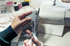 Close up fashion designer cutting cloth with equipment. Top view Stock Photos