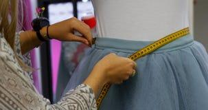Fashion designer taking measurement of customer in fashion studio 4k. Close-up of fashion designer taking measurement of customer in fashion studio 4k stock video
