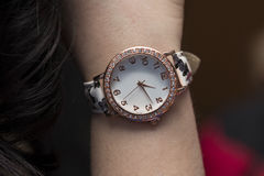 Close up fashion details, young business woman and her watch Royalty Free Stock Images
