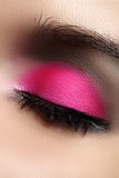 Close-up of fashion eyes make-up, bright pink eyeshadow Stock Photo