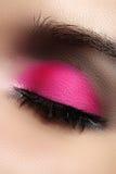 Close-up of fashion eyes make-up, bright pink eyeshadow Stock Photo