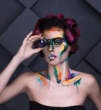 Close-up fashion faceart portrait of young girl with lens glass Stock Photo