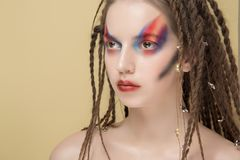 Close-Up Fashion female Model with colorful abstract makeup and dreadlocks hairstyle.  Royalty Free Stock Photo