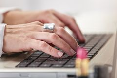 Close up of fashion hand's woman blogger working in a creative w. Young creative woman typing on a laptop in her office stock image