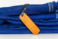 Close up of fashion jeans and lable tag.  Royalty Free Stock Images