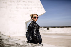 Close up fashion ;luxury portrait of stunning woman, full perfect lips and face, sunny day sunglasses and leather jacket, big. Trendy earnings, grunge urban royalty free stock photo