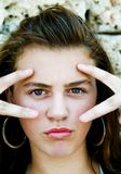Close-up of fashion model. Natural beauty looking through the finger Royalty Free Stock Photo