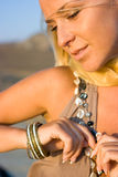 Close-up of a fashion model. Close-up portrait of a young blonde woman with bracelet on hand Royalty Free Stock Photography